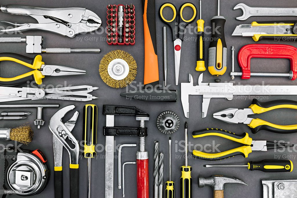 set of different hand tools on grey background stock photo