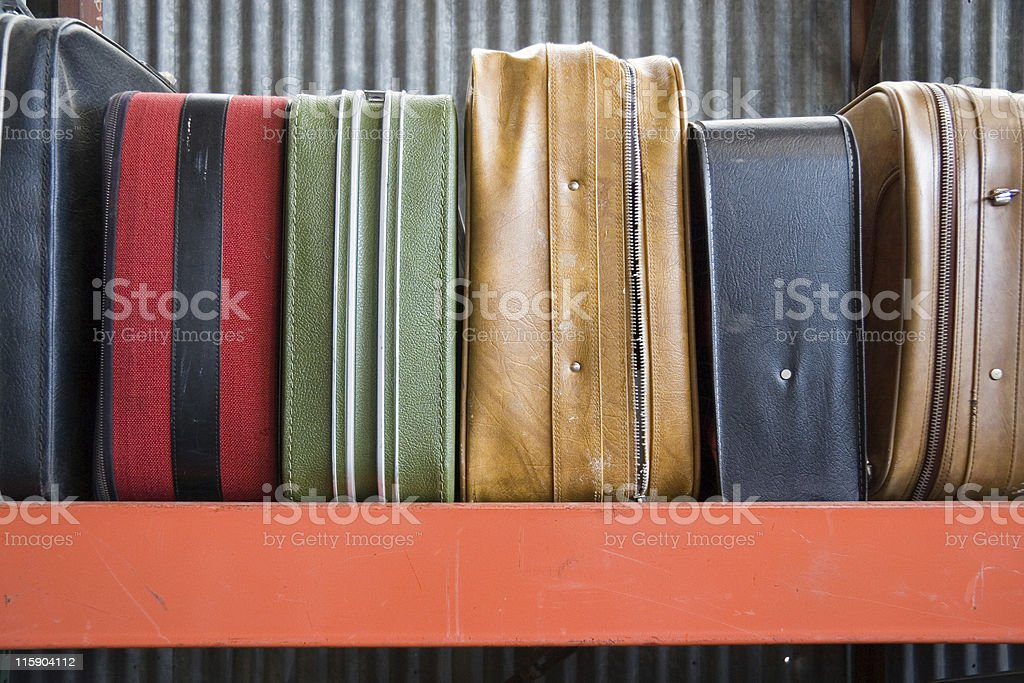 Set of different laid down suitcases royalty-free stock photo