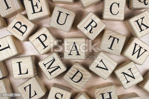 istock set of different letters on wooden cubes 1214322893