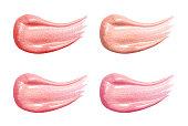 一連の異なるリップ グロス白で隔離パステル カラー塗抹標本。化粧の崩れた顔製品