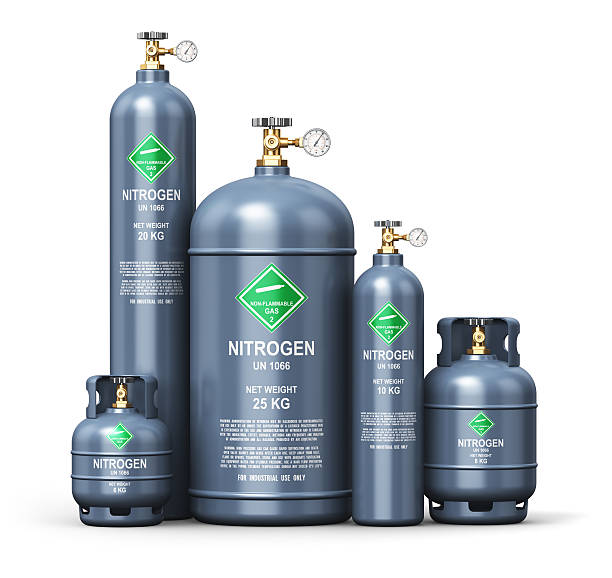 Set of different liquefied nitrogen industrial gas containers Creative abstract fuel industry manufacturing business concept: 3D render illustration of the set of gray metal steel liquefied compressed natural nitrogen gas containers or cylinders with high pressure gauge meters and valves for aluminum welding isolated on white background nitrogen stock pictures, royalty-free photos & images