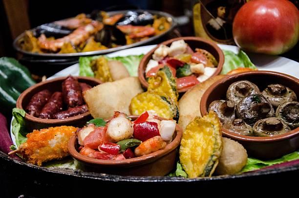 set of different meals in a bar of tapas - spanisches essen stock-fotos und bilder