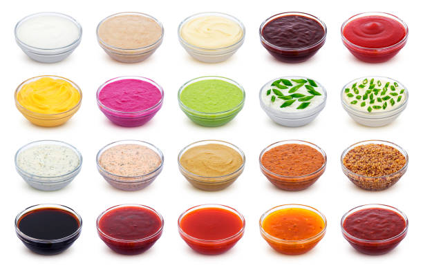 Set of different sauces isolated on white background Set of different sauces isolated on white background with clipping path savory sauce stock pictures, royalty-free photos & images