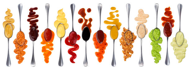 set of different sauces with spoons isolated on white background - miele dolci foto e immagini stock