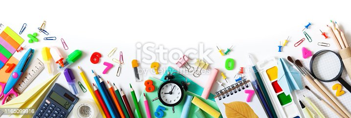 istock Set of different school stationery, alarm clock and supplies on white background. Back to school concept. Banner format. Top view. 1165099916