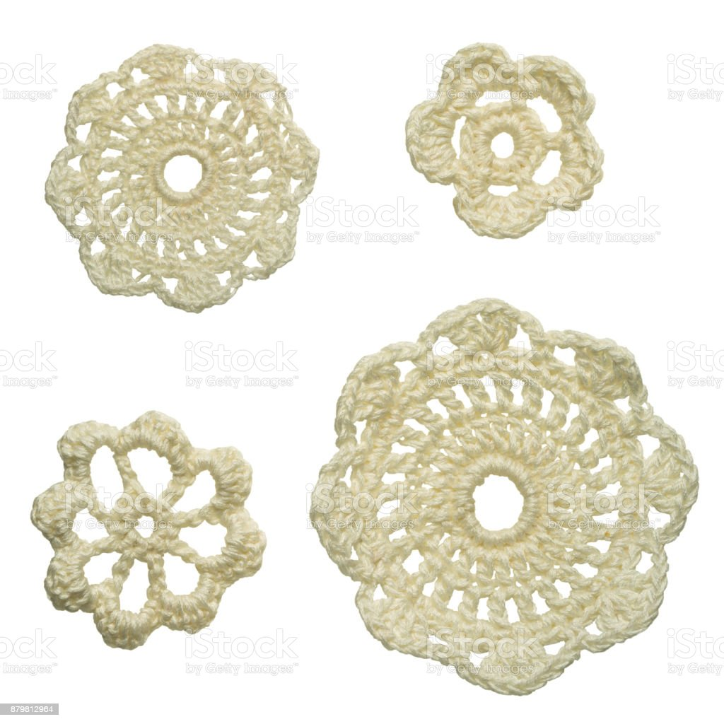 set of different size white crocheted floral doilies isolated on white background stock photo
