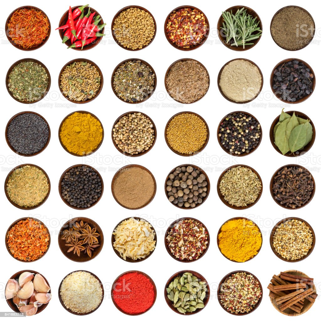 Set of different spices in wooden bowl. Top view. stock photo