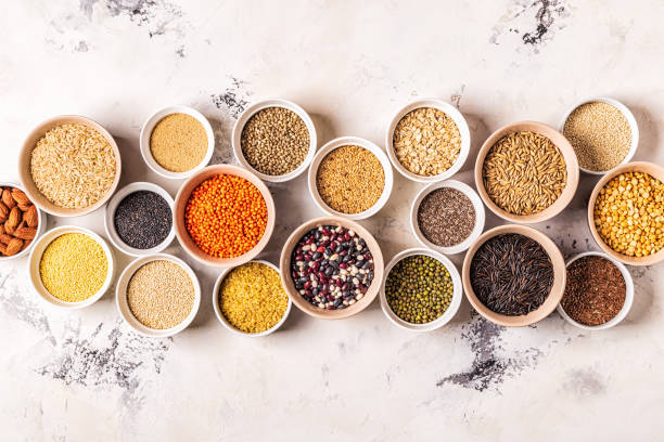 set of different superfoods- whole grains, beans and legumes, seeds and nuts - riso cereale foto e immagini stock