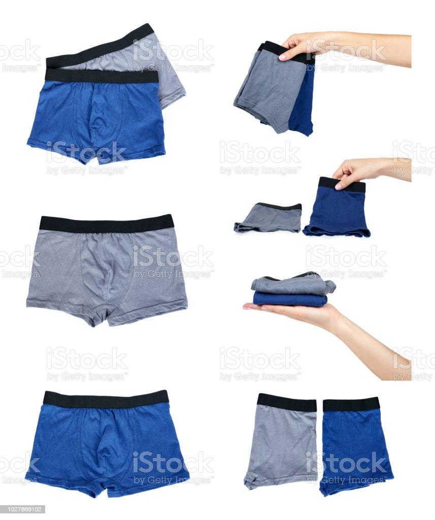 61de9bb52 conjunto de cuecas diferentes e roupas para crianças com mão isolado no fundo  branco. foto