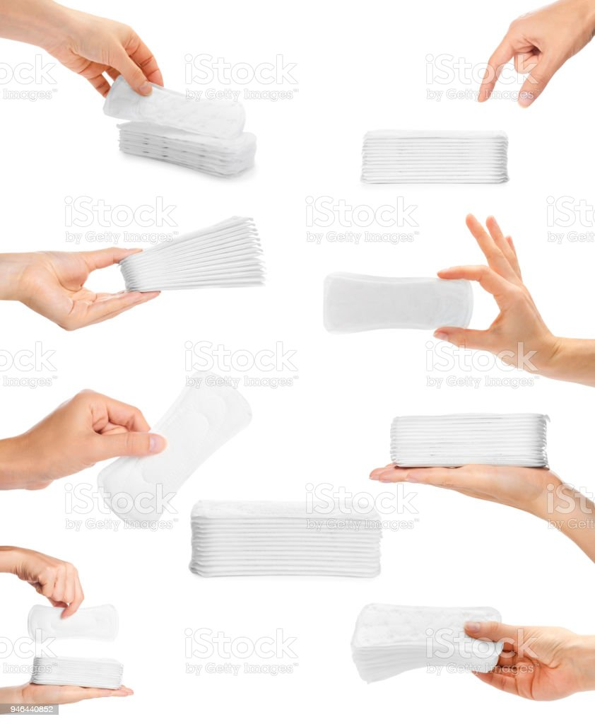 set of different white sanitary napkin with hand. isolated on white background stock photo