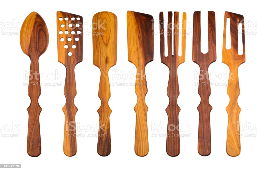 set of different wooden spoons on a white background. isolated royalty-free stock photo