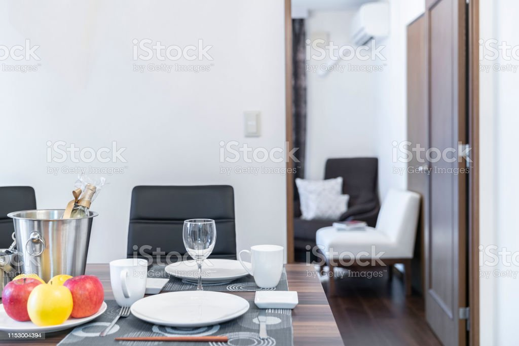 A set of dishes and a glass of wine on the dinner table