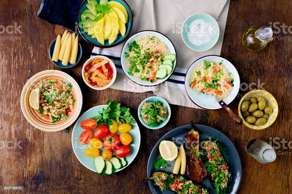 Set of dishes for healthy food on wooden table, top view. Stuffed...