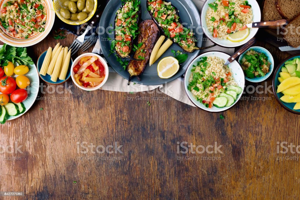Set of dishes healthy vegetarian food on wooden table with border,...