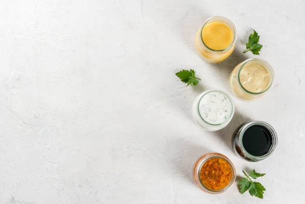 Set of dressings for salad stock photo