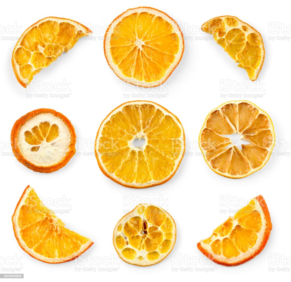 Set of dried slices and half a slice of orange and lemon, isolated on white background stock photo