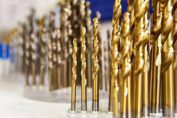 Set of drill bits for metal and wood in shop Set of drill bits for metal and wood in the shop drill bit stock pictures, royalty-free photos & images