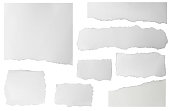 istock Set of elongated torn paper fragments isolated on white background 1286607047