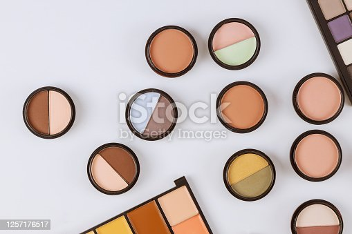 Set of eyeshadows in pastel beige colors pallet brown matte shadows, close up of make up product on an isolated white background