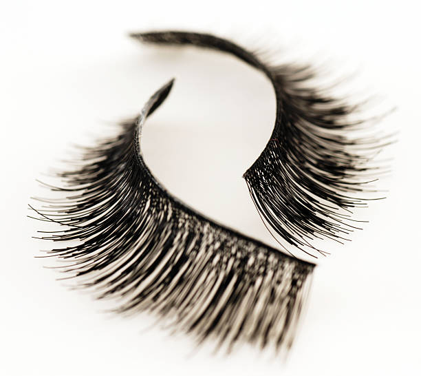 Set of false eyelashes isolated on white background High-resolution digital macro capture of a pair of false eyelashes on a white background. Shallow depth of field with a center focus. false eyelash stock pictures, royalty-free photos & images
