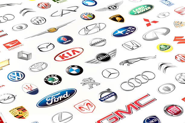 Set of famous car manufacturers logos. Zaporozhye, Ukraine - June 12, 2015: Photo of a vehicle manufacturer logos printed on paper. Include Mercedes-Benz, Nissan, Kia, Porsche, Audi, BMW, Alfa Romeo, Lexus, Honda, Opel, Land Rover and more others logo. vehicle brand name stock pictures, royalty-free photos & images