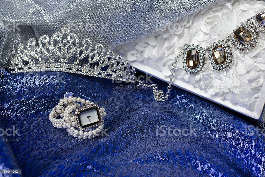Set of female accessories of hours necklace and tiara stock photo