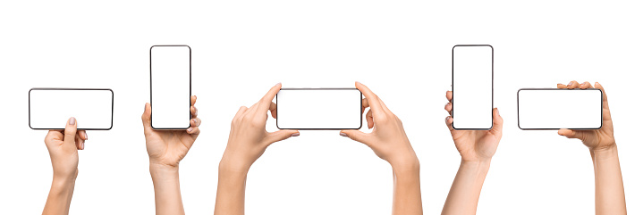 Set of female hands holding smartphone with blank screen in different orientation isolated on white background, panorama