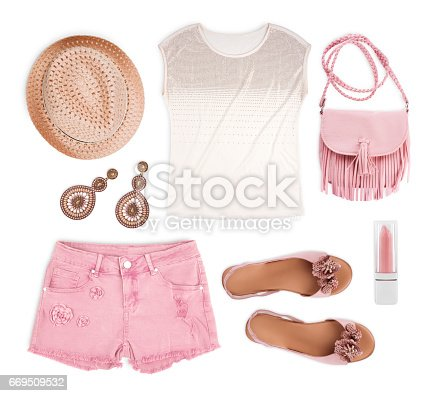 istock Set of female tourist summer clothing isolated on white background 669509532