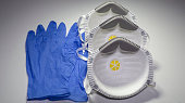 Set of FFP2 medical masks and disposable blue medical gloves. Face mask protection against pollution, virus, flu and coronavirus. Health care and surgical concept