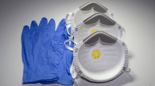 set of ffp2 medical masks and disposable blue medical gloves. face mask protection against pollution, virus, flu and coronavirus. health care and surgical concept - ffp2 imagens e fotografias de stock