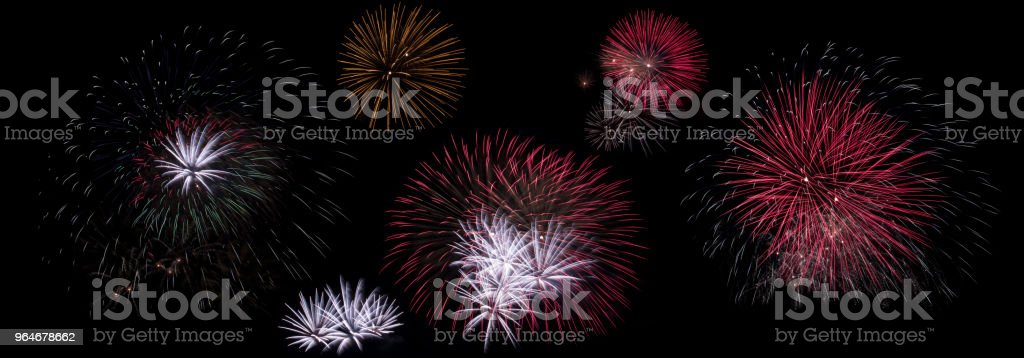 Set of fireworks explosions isolated on black royalty-free stock photo