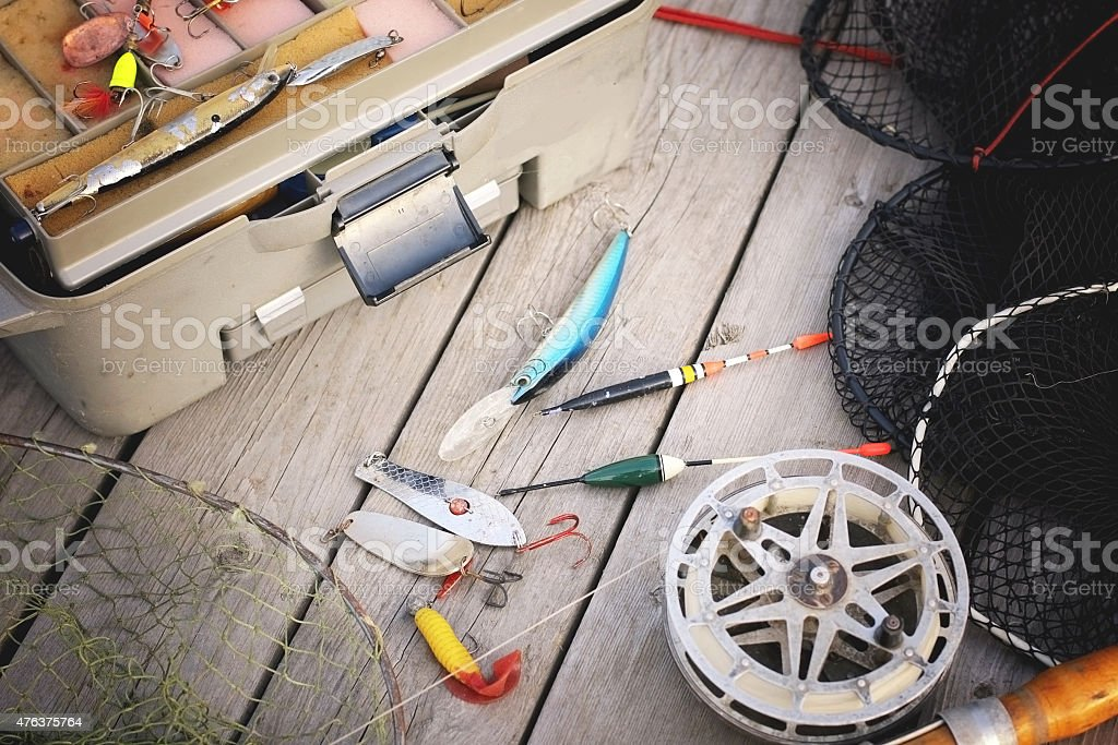 set of fisherman on a wooden background stock photo