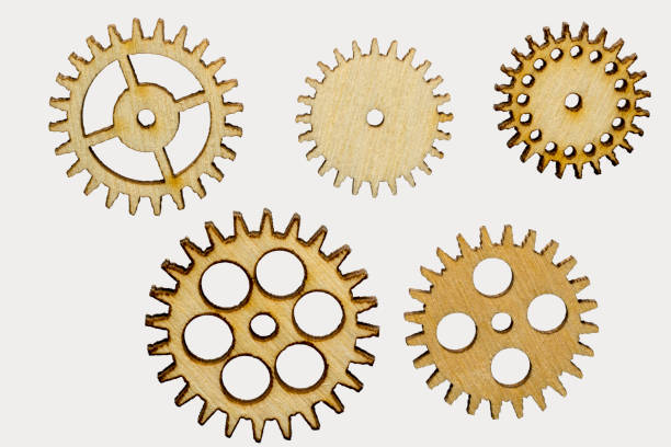 set of five different wooden cog wheels isolated on white background stock photo