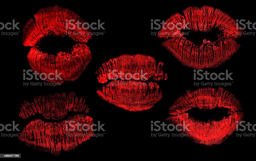 set of  five red lips imprint isolated on black stock photo