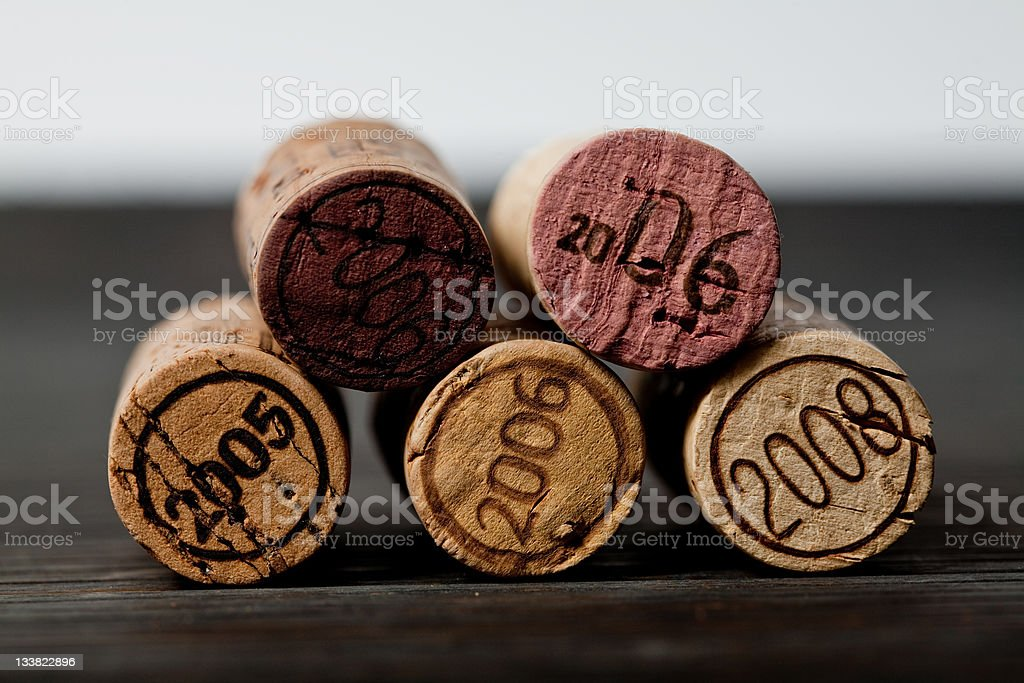 Set of five wine corks with various years engraved royalty-free stock photo