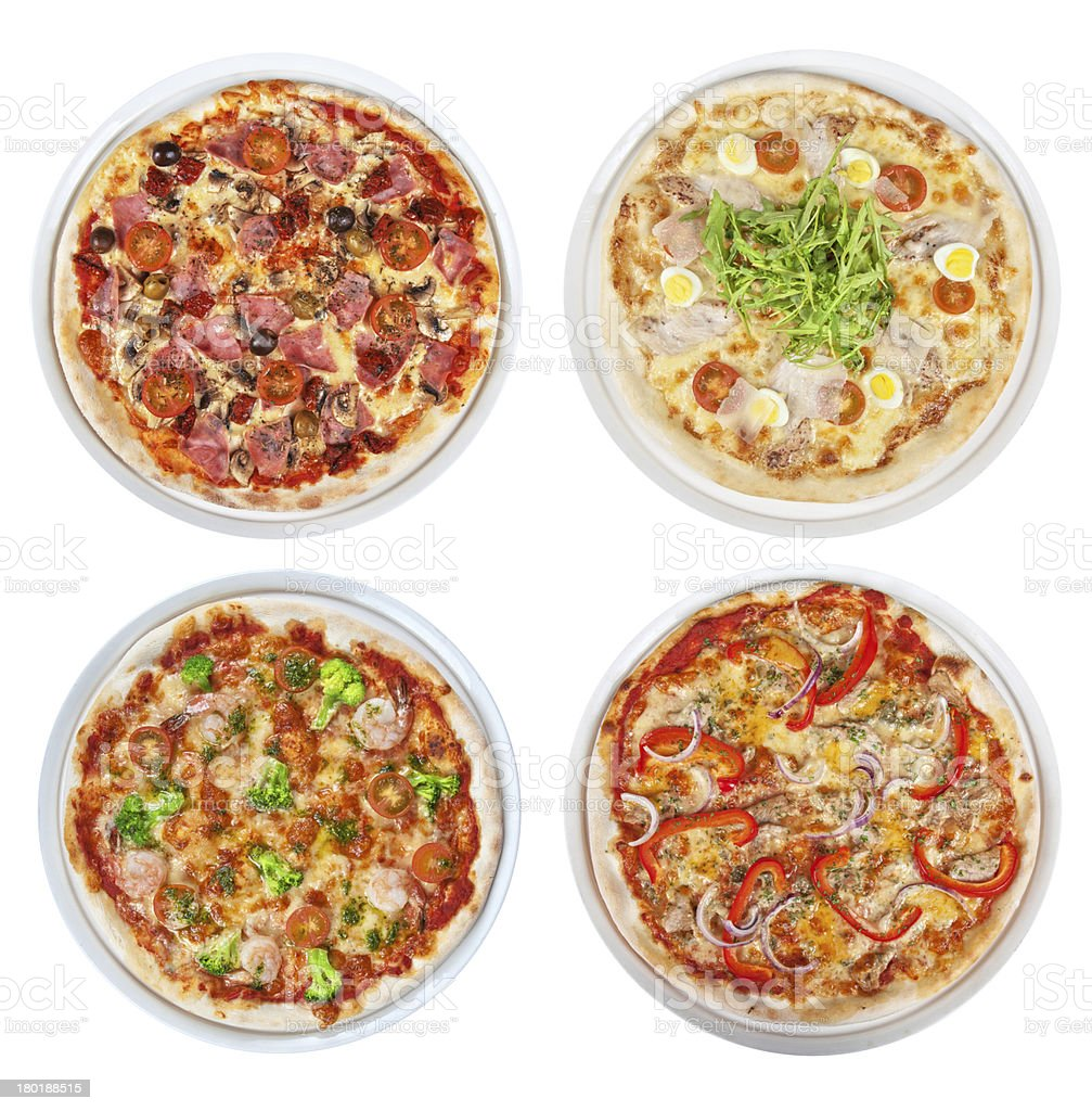 Set of four pizzas with different toppings on stock photo