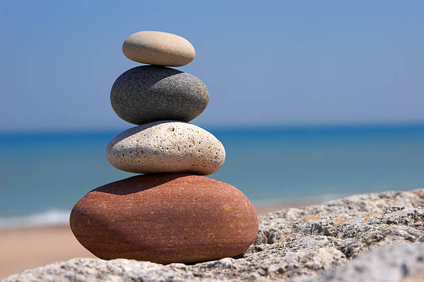 Set of four stones on top of each other signifying Zen stock photo