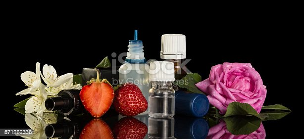 177005367 istock photo Set of fragrant liquids for smoking electronic cigarettes, berries and flowers isolated on black 871262336