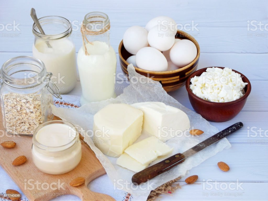 Set of fresh dairy products on wooden background: milk cheese,...