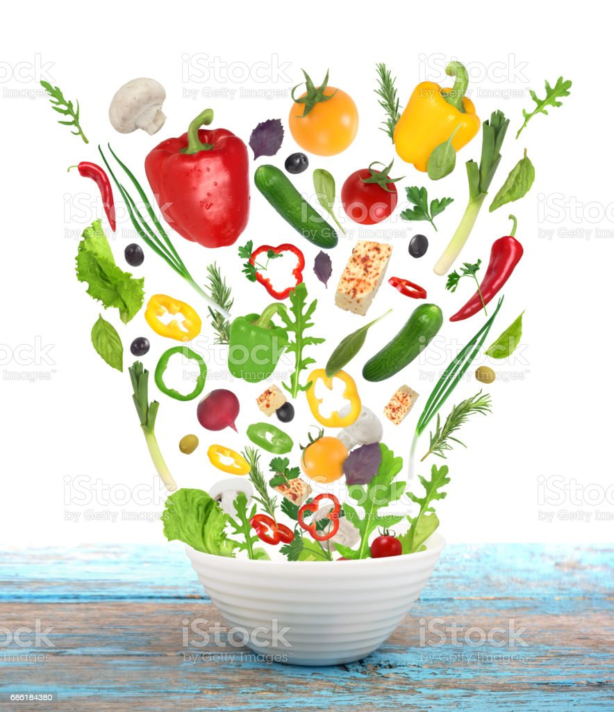 set of fresh vegetables isoleted on white background with plate on wooden table stock photo