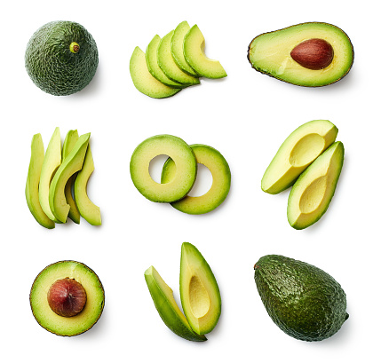 Set of fresh whole and sliced avocado isolated on white background. Top view