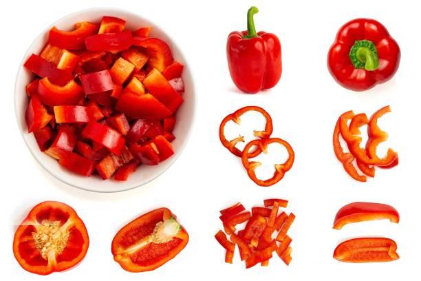 set of fresh whole and sliced bell pepper isolated on white background. top view - papryka słodka zdjęcia i obrazy z banku zdjęć