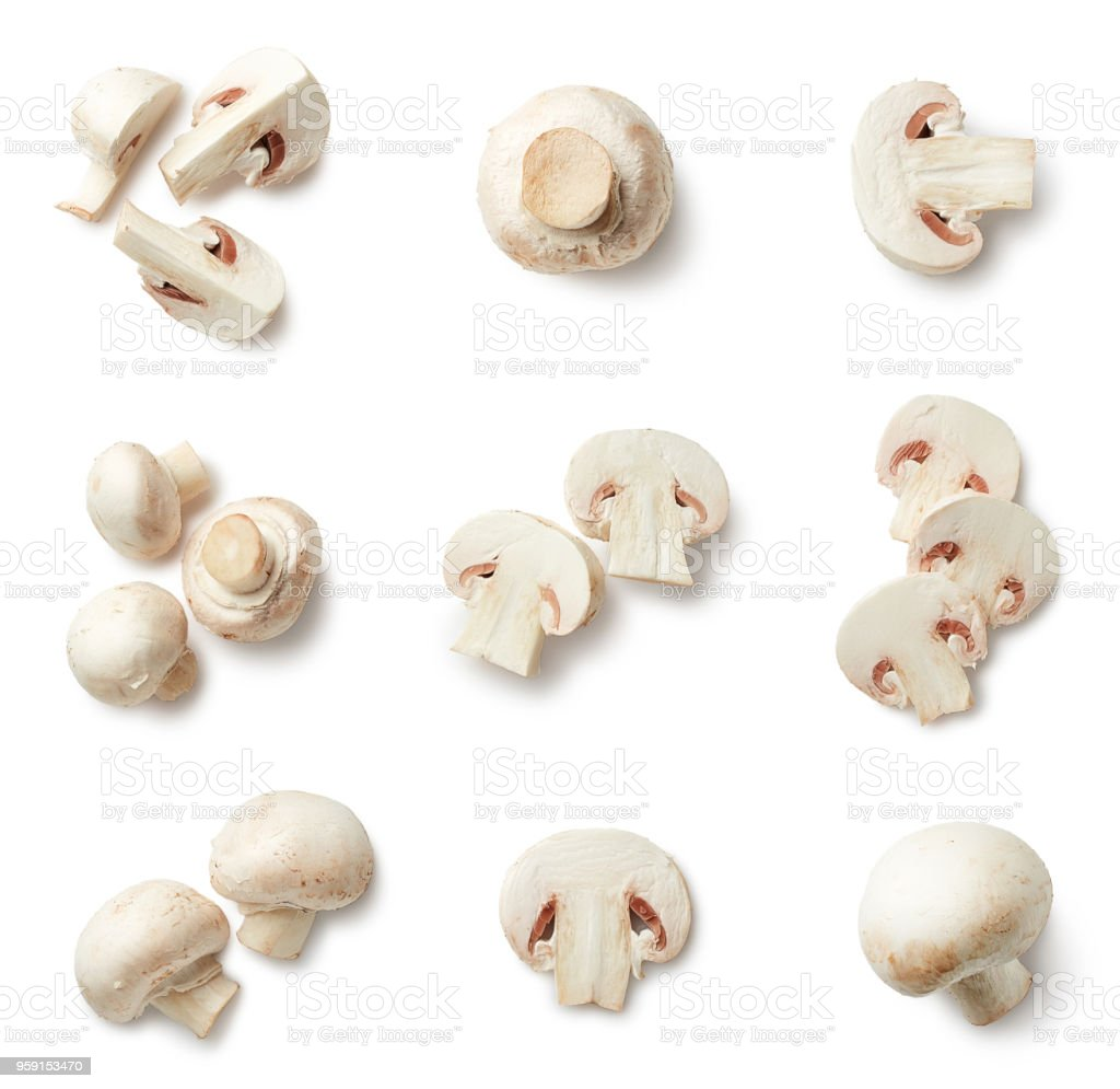 Set of fresh whole and sliced champignons stock photo
