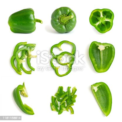 Set of fresh whole and sliced green bell pepper isolated on white background. Top view.