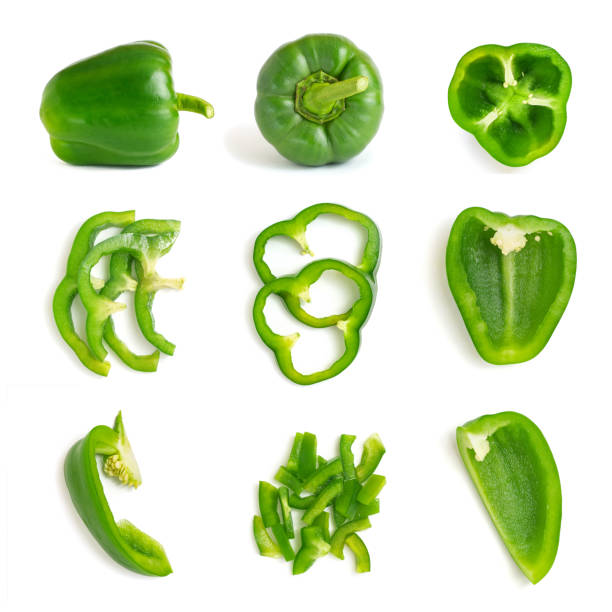 set of fresh whole and sliced green bell pepper isolated on white background. top view - papryka słodka zdjęcia i obrazy z banku zdjęć