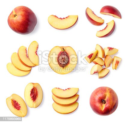 Set of fresh whole and sliced nectarine fruit isolated on white background, top view