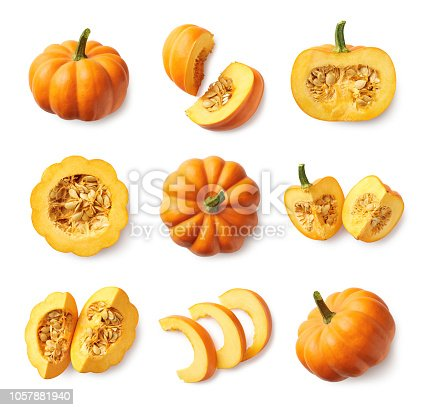 Set of fresh whole and sliced pumpkin isolated on white background. Top view