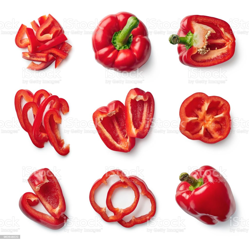 Set of fresh whole and sliced sweet pepper stock photo