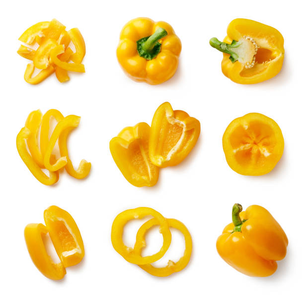 Set of fresh whole and sliced sweet pepper Set of fresh whole and sliced sweet yellow pepper isolated on white background. Top view yellow bell pepper stock pictures, royalty-free photos & images