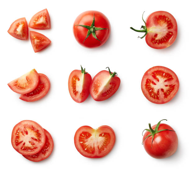 set of fresh whole and sliced tomatoes - high angle view stock pictures, royalty-free photos & images